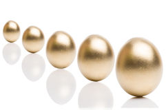 Golden eggs from  isolated on a white background. Stock Image