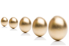 Golden eggs from  isolated on a white background. Stock Photo