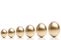 Golden eggs from  isolated on a white background. Stock Images