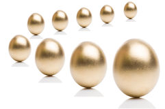 Golden eggs from  isolated on a white background. Royalty Free Stock Photo