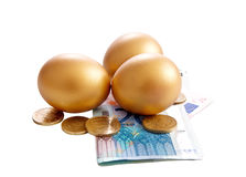 Golden eggs with money bills Royalty Free Stock Images