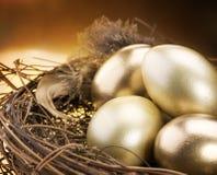 Golden Eggs in a Nest. Golden Eggs Inside a Nest. Close-up image. Business Concept Stock Photos