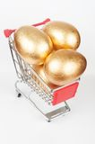 Golden eggs Stock Photos