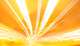 Golden electronic vibe. Streaks of bright light with an orange background Royalty Free Stock Photo