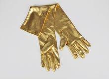 Golden elegant gloves Royalty Free Stock Photos