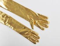 Golden elegant gloves Stock Images