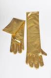 Golden elegant gloves Stock Photography