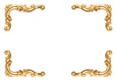 Golden elements of carved frame on white Royalty Free Stock Photography
