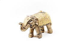 Golden elephant. Handcrafted indian elephant on white Royalty Free Stock Photography