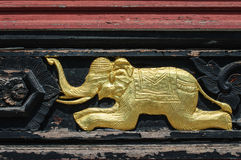 Golden Elephant. Carved wooden elephant at Thailand Royalty Free Stock Photos