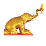 Golden elephant sitting at Thai temple isolated on white Royalty Free Stock Photos