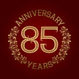 Golden emblem of eighty fifth anniversary. Celebration patterned sign on red.  Vector Illustration