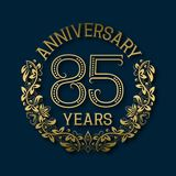 Golden emblem of eighty fifth years anniversary. Celebration patterned logotype. With shadow on blue vector illustration