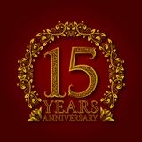 Golden emblem of fifteenth years anniversary. Celebration patterned logotype with shadow on red.  Royalty Free Stock Images