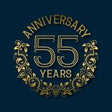 Golden emblem of fifty fifth years anniversary. Celebration patterned logotype. With shadow on blue stock illustration