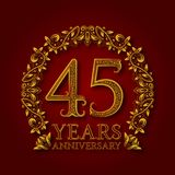 Golden emblem of forty fifth years anniversary. Celebration patterned logotype with shadow on red.  Stock Photo