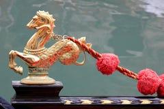 Golden  emblem. Photo image with  particular  golden emblem  gondola of venice Stock Images