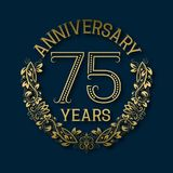 Golden emblem of seventy fifth years anniversary. Celebration patterned logotype. With shadow on blue stock illustration