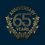 Golden emblem of sixty fifth years anniversary. Celebration patterned logotype. With shadow on blue stock illustration