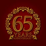 Golden emblem of sixty fifth years anniversary. Celebration patterned logotype with shadow on red.  Royalty Free Stock Images