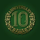 Golden emblem of tenth anniversary. Celebration patterned logotype. With shadow on green stock illustration
