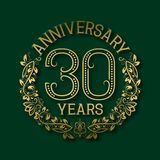 Golden emblem of thirtieth years anniversary. Celebration patterned logotype. With shadow on green royalty free illustration