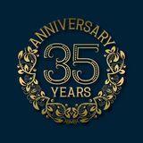 Golden emblem of thirty fifth years anniversary. Celebration patterned logotype. With shadow on blue vector illustration