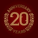 Golden emblem of twentieth anniversary. Celebration patterned sign on red.  Vector Illustration