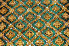 Golden and emerald wall decoration on temple in Th Royalty Free Stock Photography