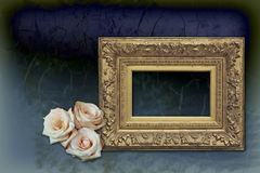 Golden empty frame with pink roses. A baroque golden frame with three pink roses on a silk background stock images