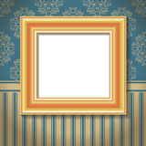 Golden empty frame on the wall Royalty Free Stock Photos