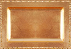 Golden empty plate surface texture Royalty Free Stock Image