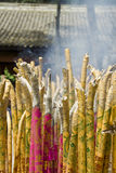 Golden en magenta incense sticks Stock Photo