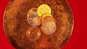 Golden end silver bitcoin coins on golden pan stock video footage