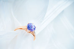 Golden engagement ring Stock Photos