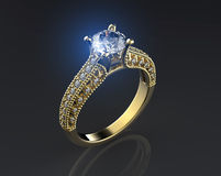 Golden Engagement Ring with Diamond. Royalty Free Stock Photos