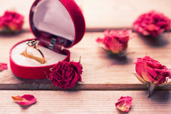 Golden engagement ring in a heart shaped box Royalty Free Stock Photo