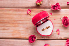 Golden engagement ring in a heart shaped box stock photo