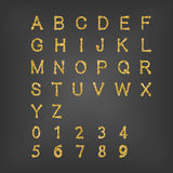Golden English alphabet and numbers. Stock Photo