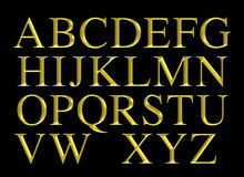 Golden engraved alphabet lettering set Royalty Free Stock Photography