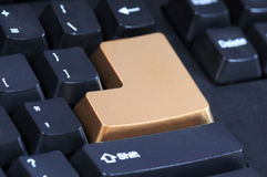 Golden enter key Royalty Free Stock Photography