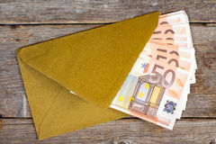 Golden envelope with Euro bills Royalty Free Stock Photography