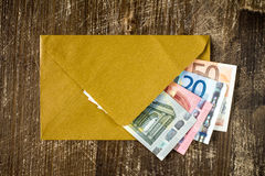 Golden envelope with Euro bills. Stock Photography