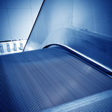 Golden escalator Stock Photos
