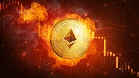 Golden Ethereum coin falling in fire flame. Golden Ethereum coin in fire flame is falling. Burning crypto currency Ethereum falling down, blockchain Stock Images