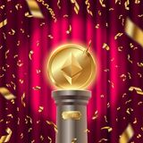 Golden ethereum coin on a pedestal on a stage in spot of light and golden confetti against the red curtain background. Golden ethereum coin on a pedestal on a Royalty Free Stock Image