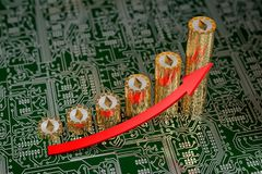 Golden Ethereum coins on a circuit board Stock Images