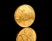 Golden euro coin on a black reflecting background Royalty Free Stock Photography