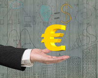 Golden euro sign in male hand Royalty Free Stock Image