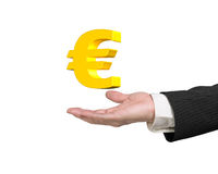 Golden euro sign in man's hand Royalty Free Stock Images